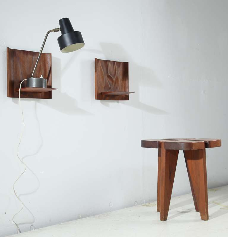 pair of sculptural wooden wall shelves by roger sloan at