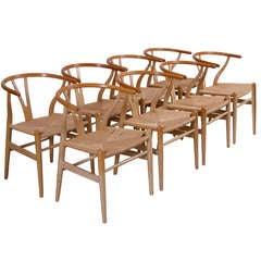Set of 8 Hans Wegner Wishbone Dining Chairs in oak by Carl Hansen