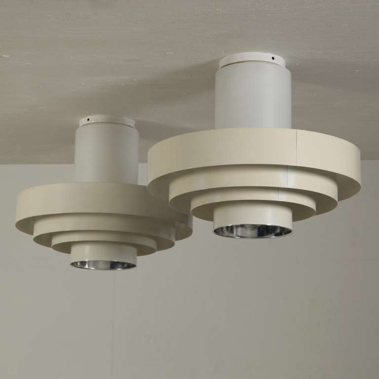 Pair of off-white ceiling fixtures with glass cylindric ceiling fixing and 4 metal rings.