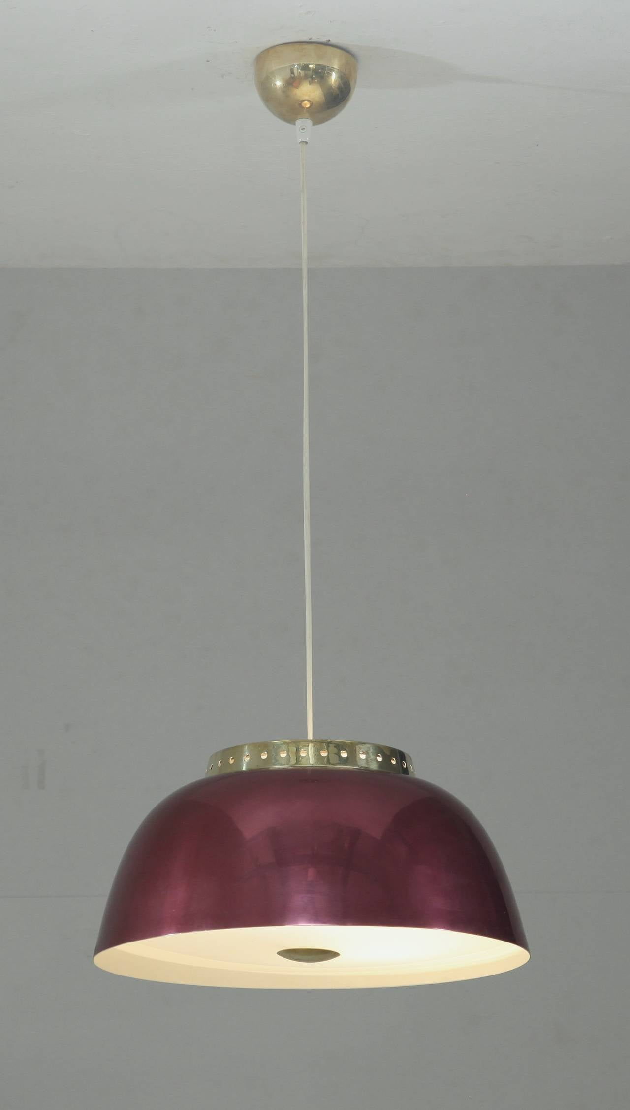 A rare Lisa Johansson-Pape model 61-334 pendant for Orno. The lamp is made of a wonderful burgundy metal shade with brass elements and an opaline glass diffuser.