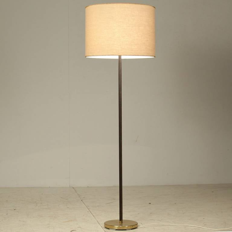 Pair minimal floor lamps with leather stem and cream shade kalmar pair of kalmar floor lamps with leather around the stem and a heavy metal base aloadofball