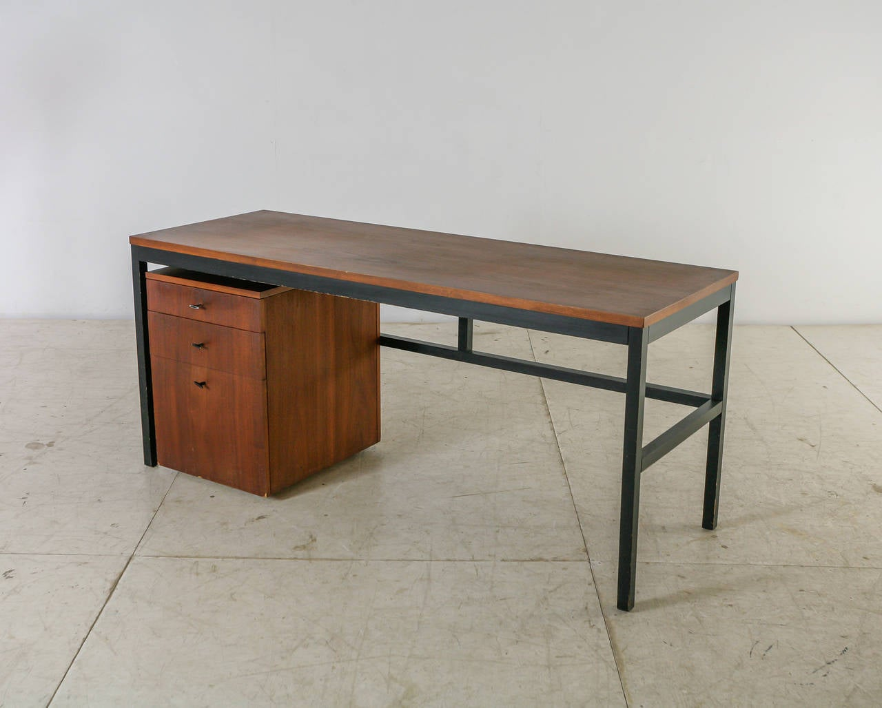 A Milo Baughman desk annex console table, with a free standing chest of drawers on wheels, for Directional Furniture.   Without the cube with the drawers, the table can also function as a console table. The desk is made of a walnut top on an