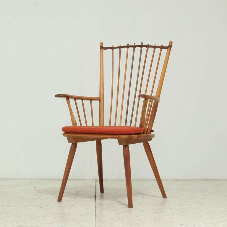A published  architectural arts and crafts chair by Albert Haberer for  Hermann Fleiner, Stuttgart, ca 1950.  The leather connection is a beautiful detail that makes the chair wonderful to sit in. We have three different chairs from this series