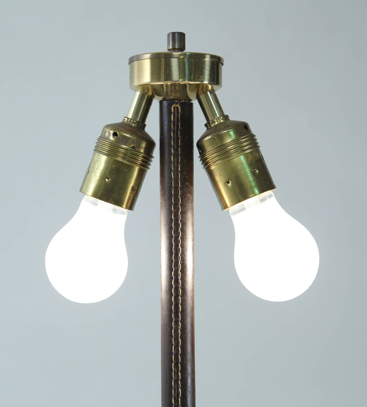 Pair of minimal floor lamps with leather stem and long for Floor lamp glass stem