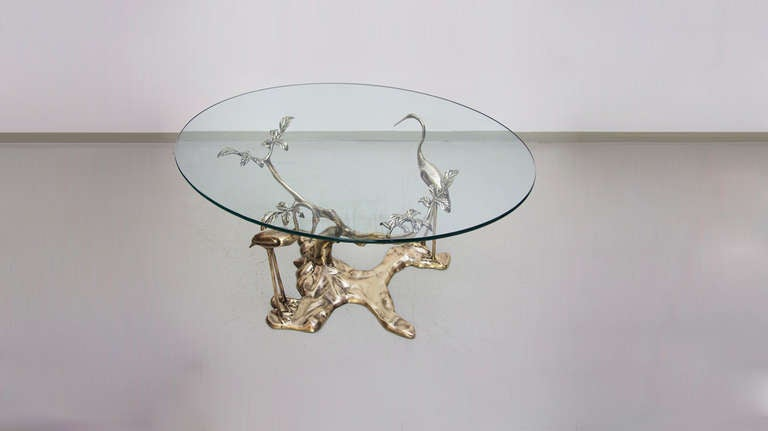 Solid willy daro coffee table with oval glass top at 1stdibs