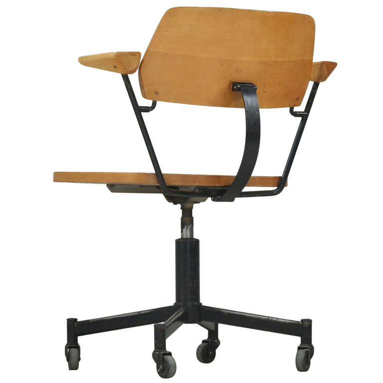 Desk chair on wheels with solid wooden carved out seat at 1stdibs