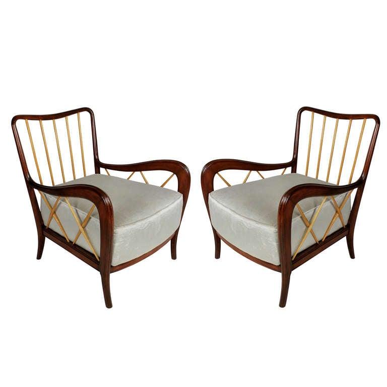 A Pair Of Mahogany And Ash Club Chairs By Paolo Buffa At