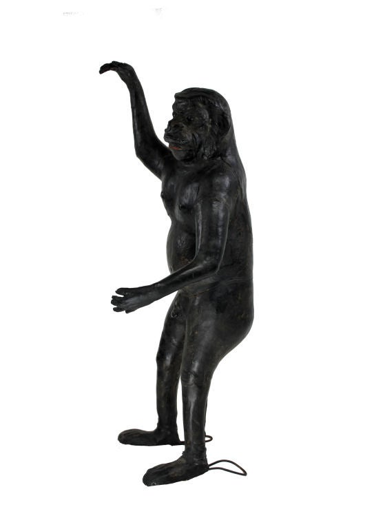 A French freestanding lifesize figure of a monkey fashioned out of leather with green glass eyes. This object would have been made as a souvenir and curiosity for a wealthy household around the time the Europeans were exploring Africa.