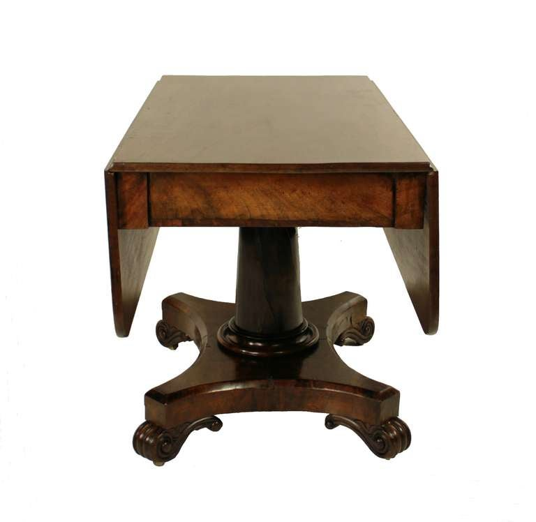 An English William Iv Mahogany Pedestal Drop Leaf Table With A Cutlery Drawer