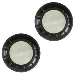 A Pair Of English Bronzed Circular Cushion Mirrors