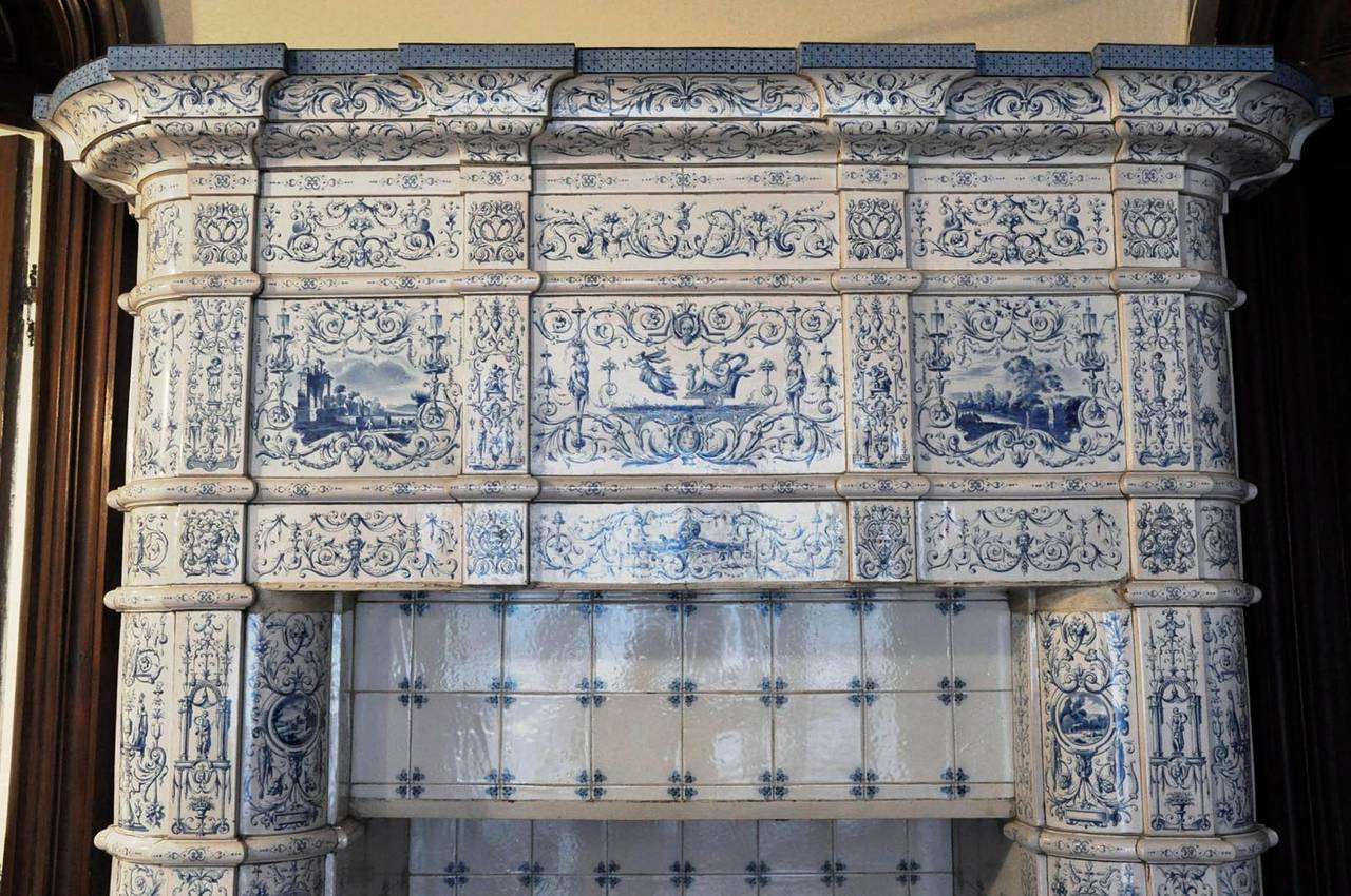 Antique Ceramic Fireplace with Blue Decor on a White