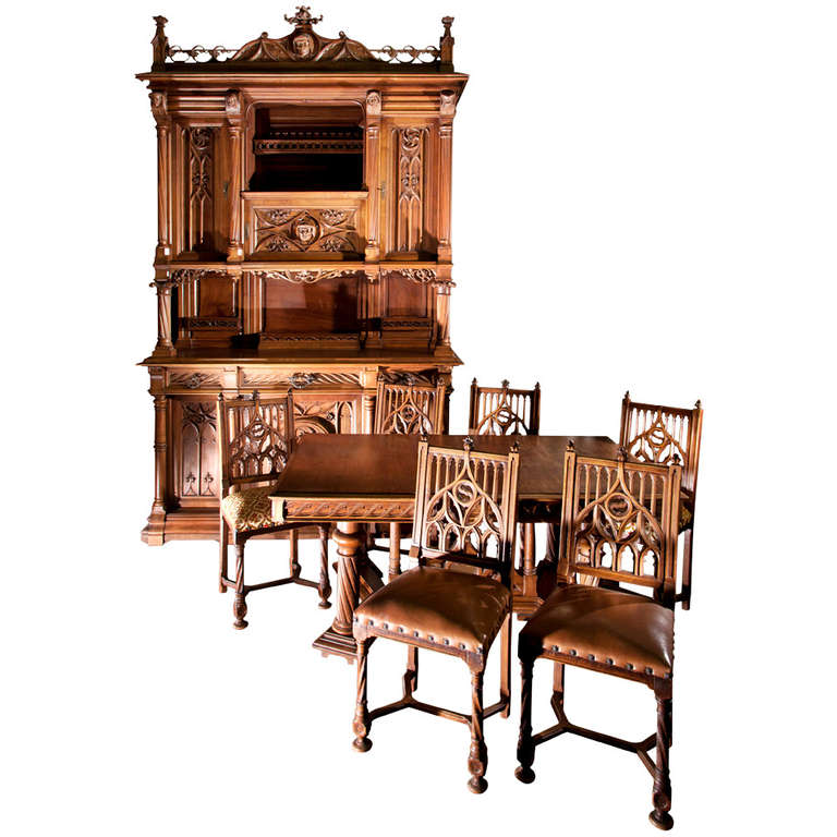 Antique neogothic style dining room set of carved walnut for Antique dining room sets
