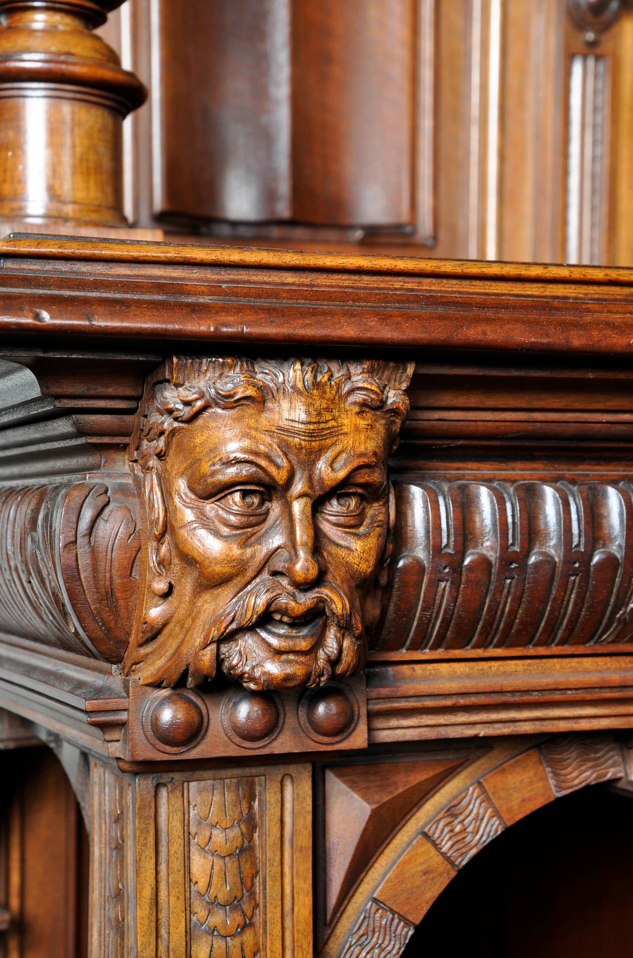 Neo gothic style carved walnut dresser with satyrs decor