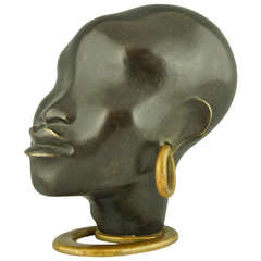 A Head of an African Woman with Earring on Oval Base by F. Hagenauer