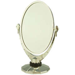 An Oval Art Deco Mirror with Beveled Glass by Atelier Raynaud, France
