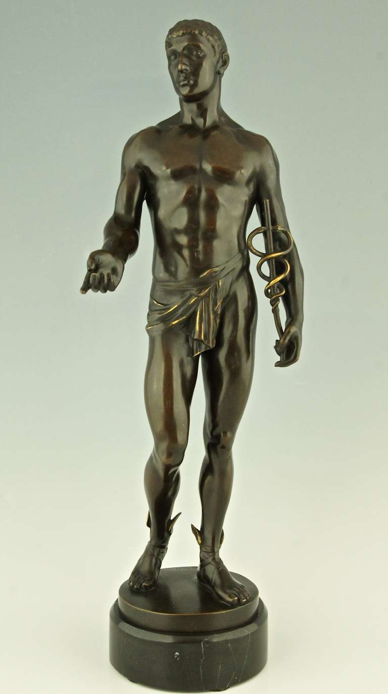 Bronze sculpture of Mercurius or Hermes holding the Caduceus and wearing winged sandals by Rudolf Kaesbach. Ca. 1900. Material: Patinated bronze on a marble base.  Origin: Germany.  Size: H. 19.5 inch x L. 6.7 inch x W. 6.7 inch.