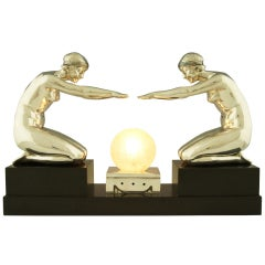Art Deco silvered bronze lamp with two kneeling nudes by Pierre Lenoir