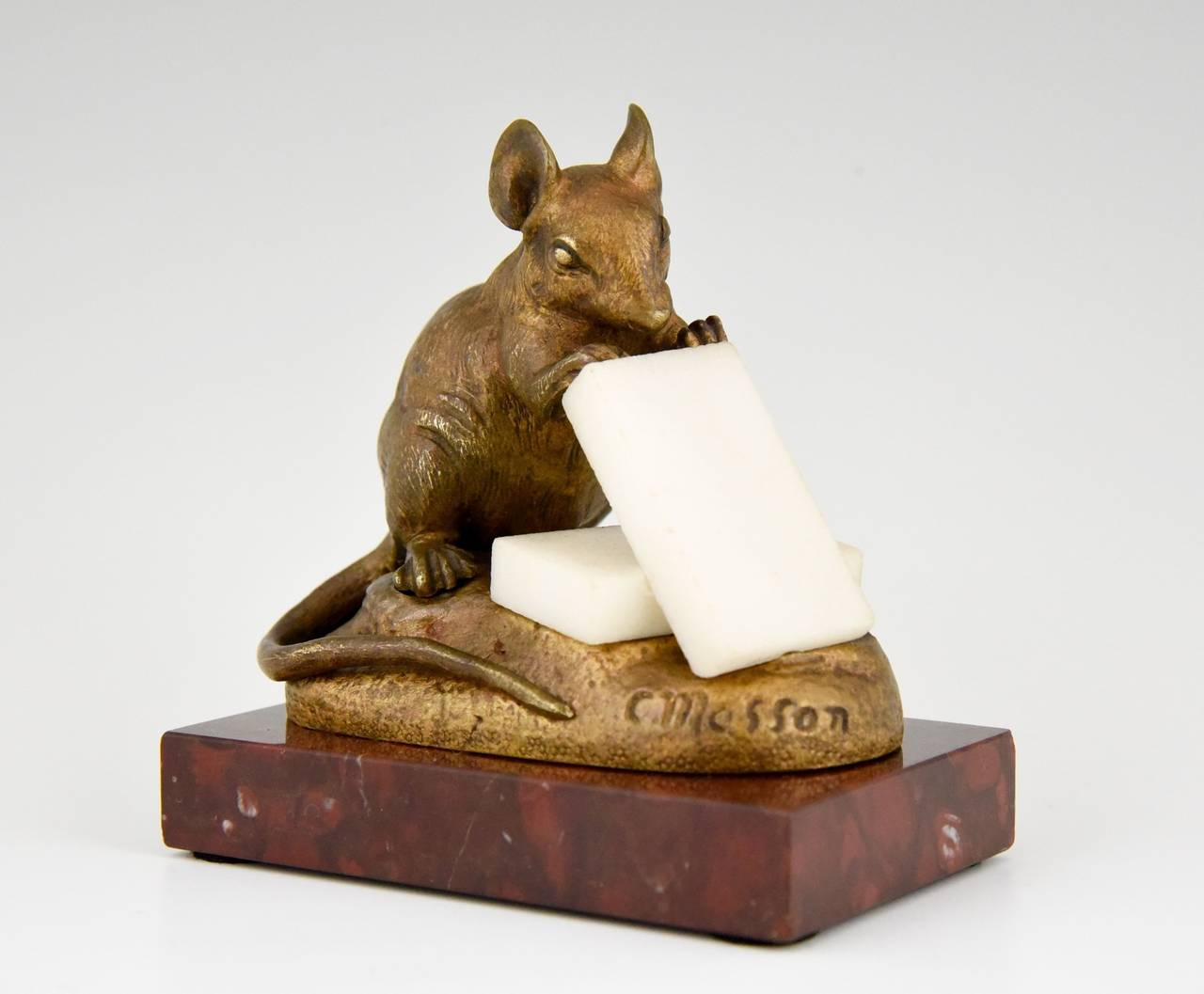 Description: Mouse eating cheese.  Artist/ Maker: Masson, Clovis.  Signature/ Marks: C. Masson. Style: Romantic.  Date: 1880.  Material: Bronze, alabaster on a red marble base. Origin: France.  Size: H. 3.7 inch x L. 3.7 inch. x W.