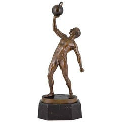 Antique Sculpture of a Male Nude Athlete with dumbbell by Peleschka 1900