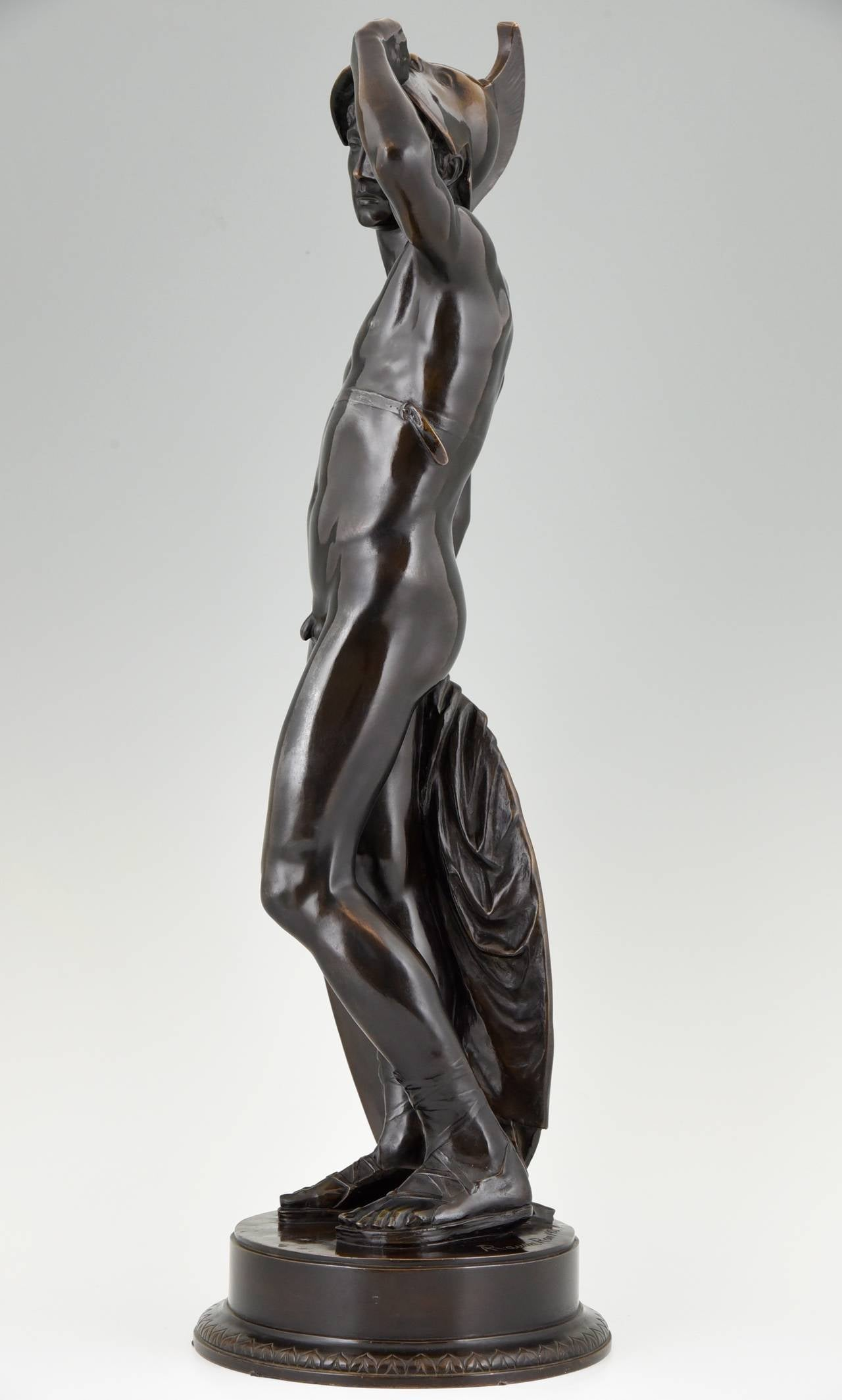 Antique sculpture of a standing male nude with helmet. 