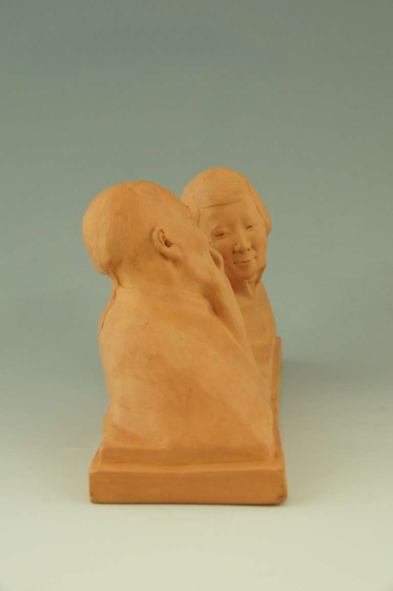 Terracotta Art deco sculpture of a Chinese couple by Gaston Hauchecorne, 1925.