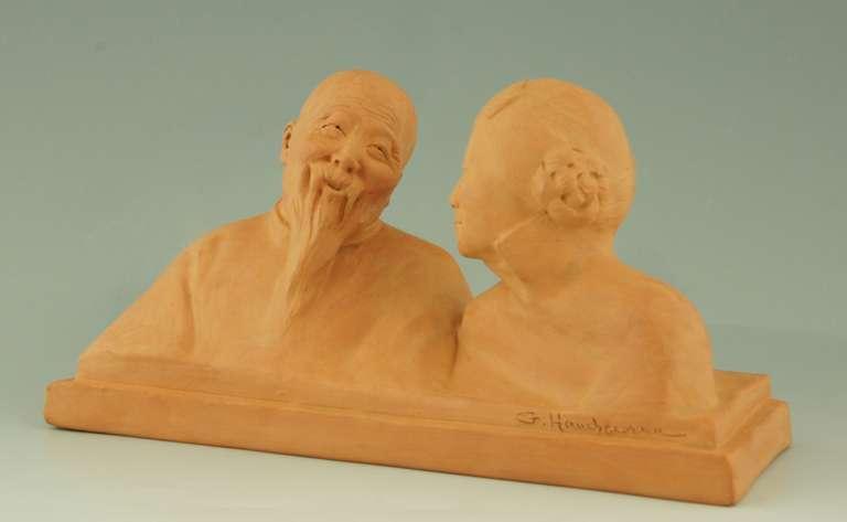 A terra cotta sculpture of a young Chinese woman listening to an older man by Gaston Hauchecorne.   Size: H. 4.2 inch x L. 9.2 inch x W. 3.2 inch.  H. 12 cm x L. 23.5 cm. x  W. 8 cm.   Literature: Dictionnaire des peintres, sculpteurs,
