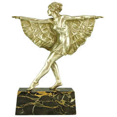 Art Deco silvered bronze dancer with butterfly dress by Marcel Bouraine.