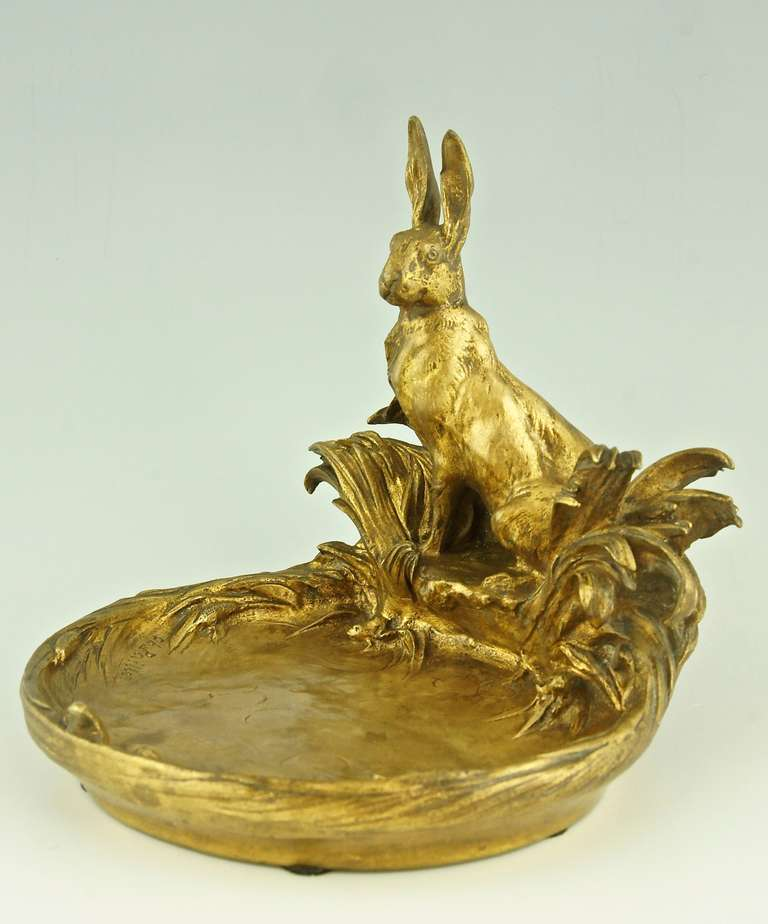 Sculptural gilt bronze tray with a hare sitting at a pond.  Four frogs are coming out of the water. By Charles Paillet,  France 1871-1937 Foundry: F. Barbedienne Fondeur Paris.  Size:  H 16 cm. x L. 16 cm. x W. 17 cm. H. 6.3 inch x L. 6.3