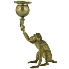 Vienna bronze of a monkey with candlestick holder.