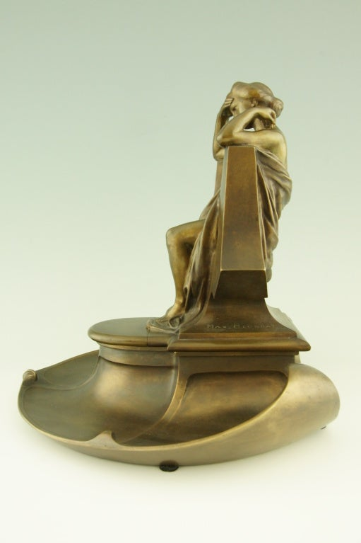 A bronze inkwell with lady sitting on a throne by Max Blondat (1879-1926)