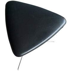 Triangular stool designed in the 1950's by Vladimir Kagan.