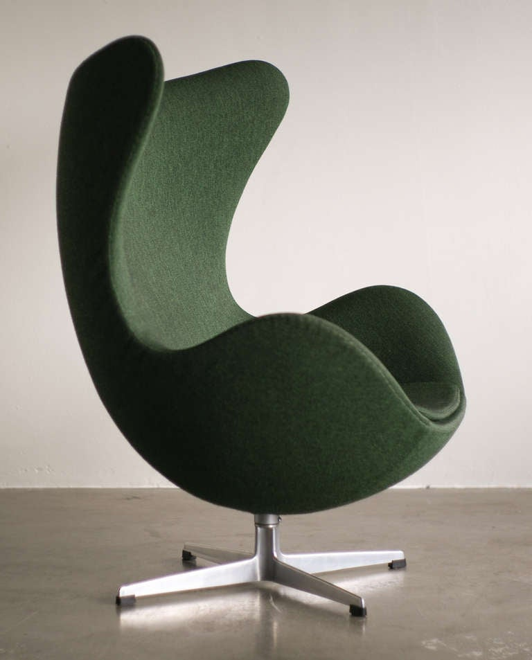 Iconic classic in a wonderful 2-tone green fabric. We offer museum quality crating and affordable worldwide shipping. Feel free to inquire!