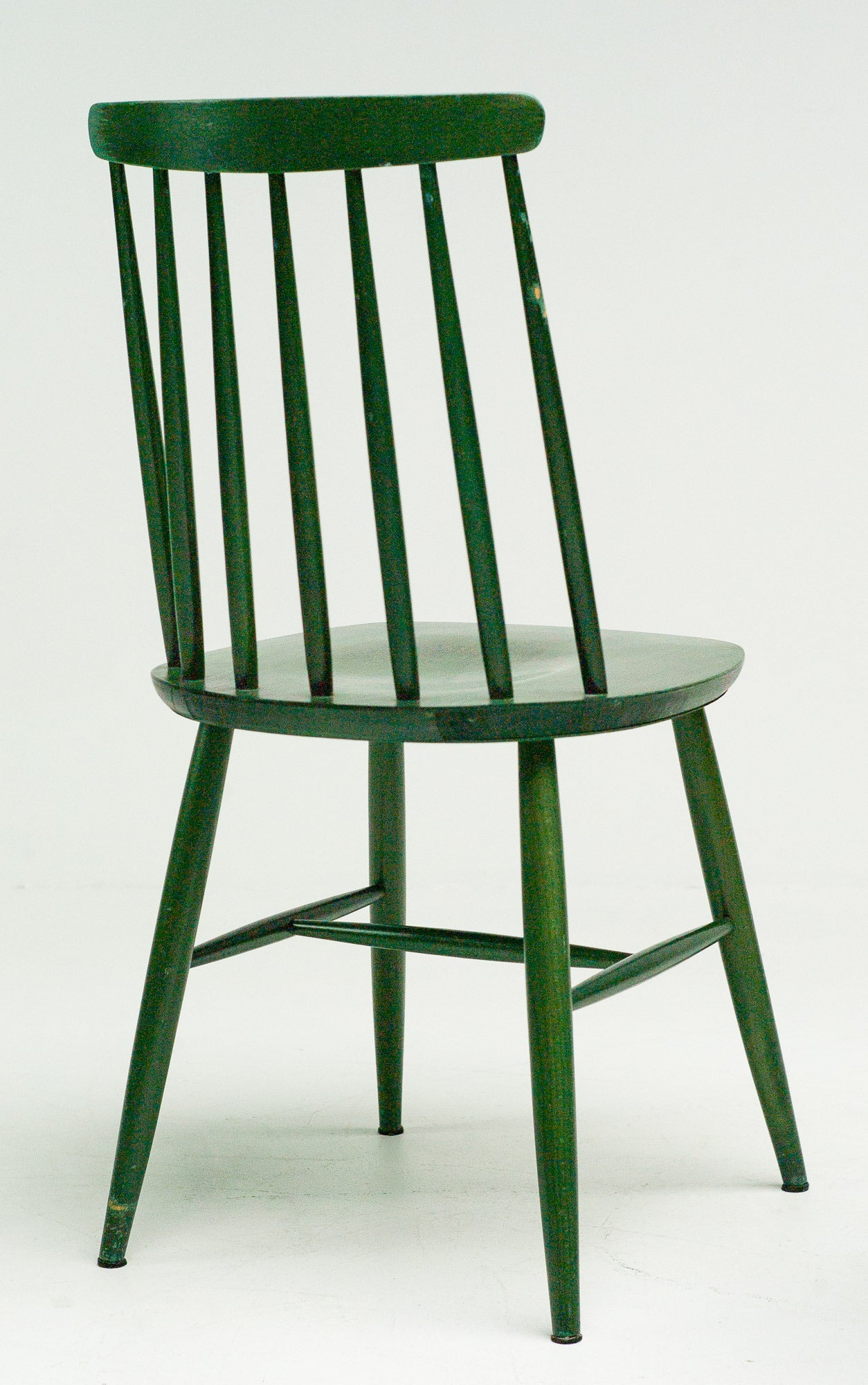 Pair of green dye spindle back dining chairs by Ilmari Tapiovaara.  Excellent fast and affordable worldwide shipping. White glove delivery available upon request.