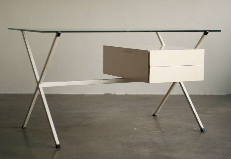 Early edition of this minimalist pedestal desk with glass top. All original unrestored condition. We offer museum quality crating and affordable worldwide shipping. Feel free to inquire!