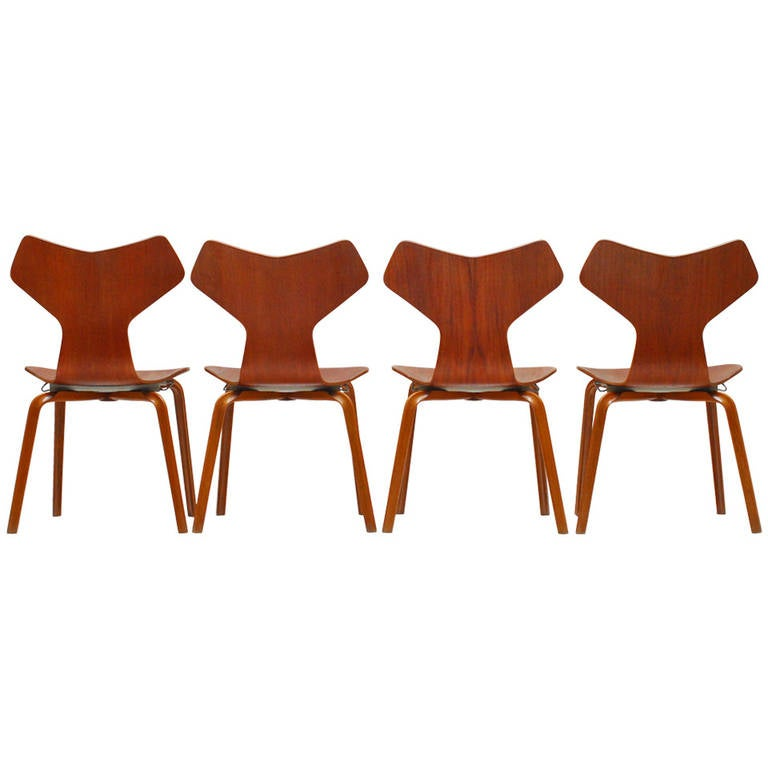 set of four teak grand prix plywood chairs by arne. Black Bedroom Furniture Sets. Home Design Ideas