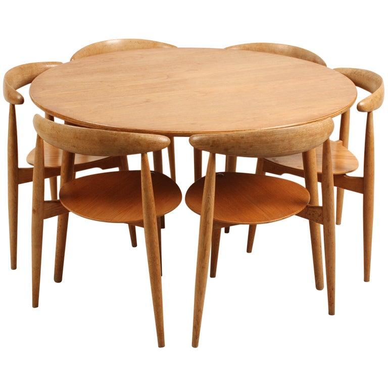 Danish Hans Wegner Three Legged Dining Set : XXXhanswegner302110 from 1stdibs.com size 768 x 768 jpeg 61kB