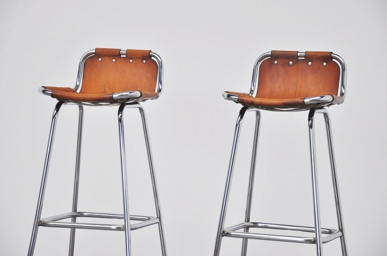 Cool and highly wanted stool by Charlotte Perriand for ski resort Les Arcs in 1960. This is for the nicest version, high stools in good original condition. The stools have chrome tubular frames and high quality thick natural leather seats. The