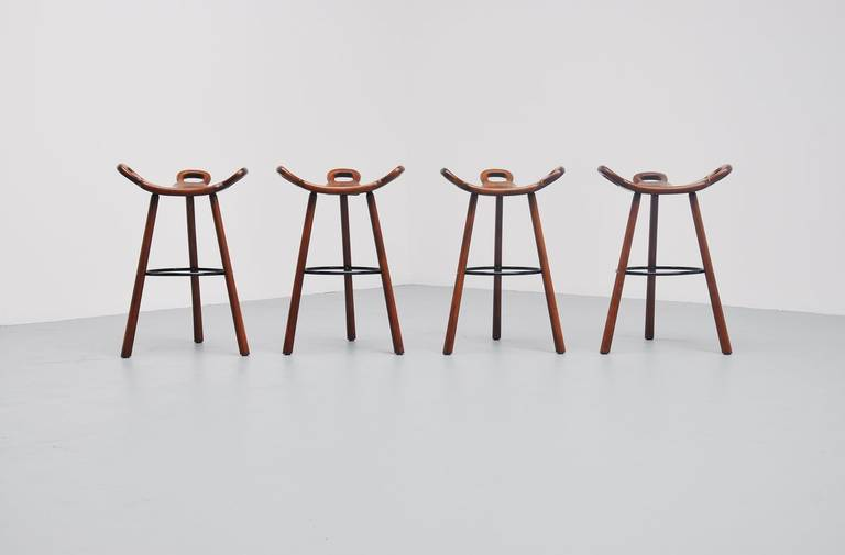 Very nice brutalist bar stools, model Marbella imported from Spain by Confonorm, 1970. Very nice stained oak wooden stools with metal feet supporting ring. Stools are very comfortable for any person and look amazing in any home or interior. We