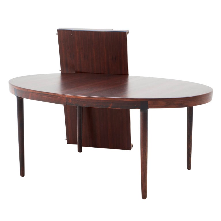 Oval rosewood dining table with two extension leaves at for Dining table with two leaves