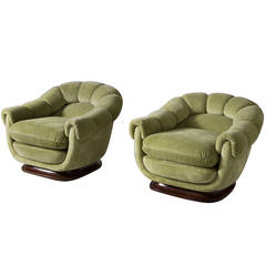 Two Elegant Club Chairs with Round Shapes