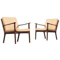 Pair of Ole Wanscher Lounge Chairs in Solid Rosewood