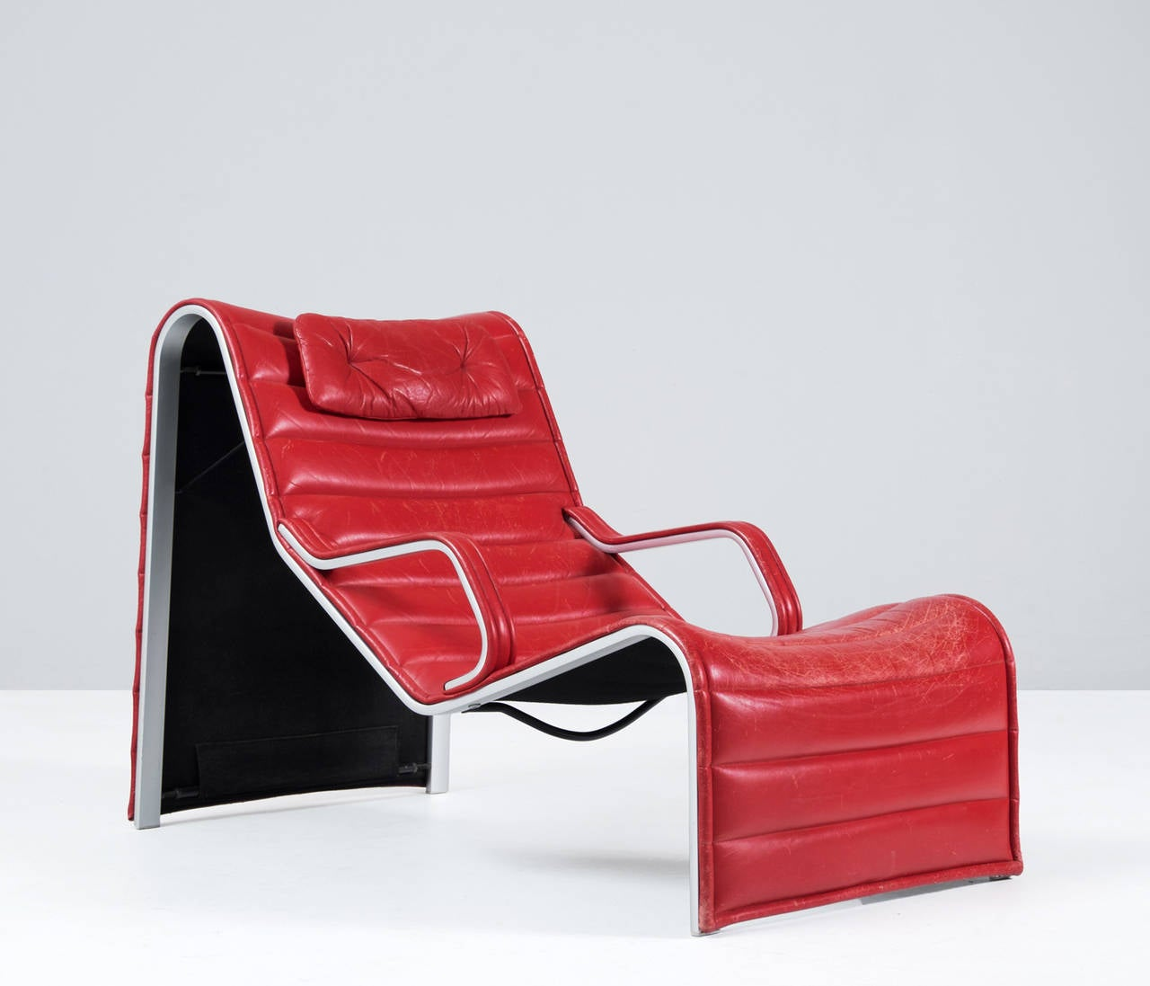 very comfortable chaise longue in aluminum and red leather. Black Bedroom Furniture Sets. Home Design Ideas