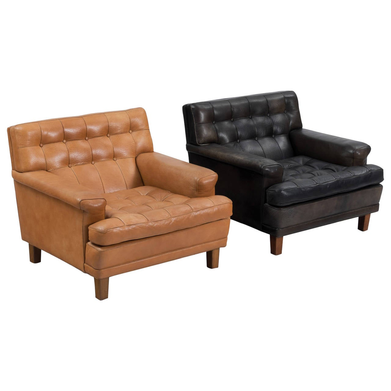 arne norell pair of easy chairs in black in cognac leather for sale at