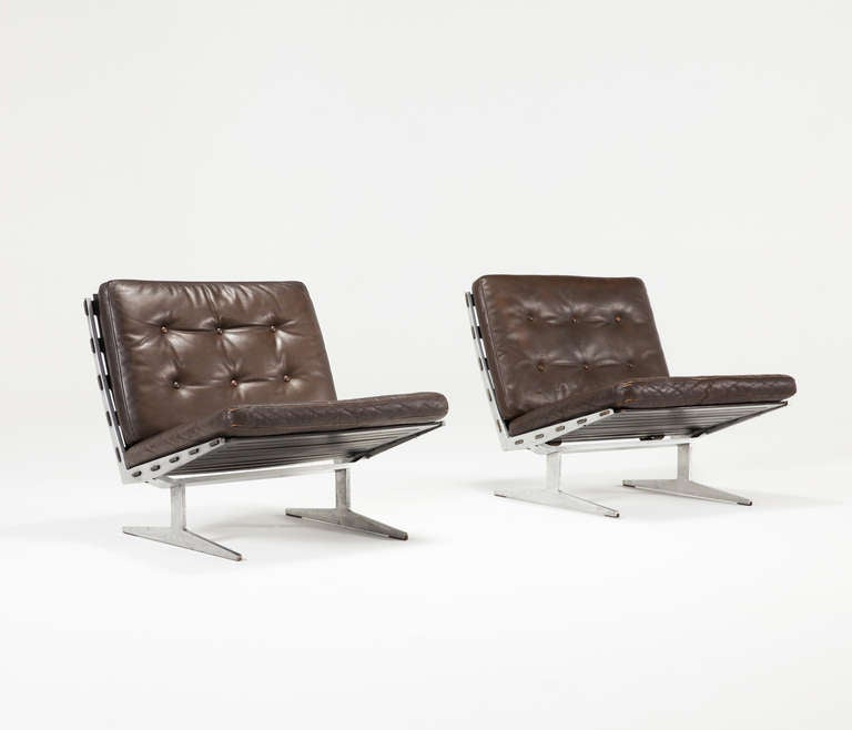 Pair of brown leather slipper chairs with aluminum frame