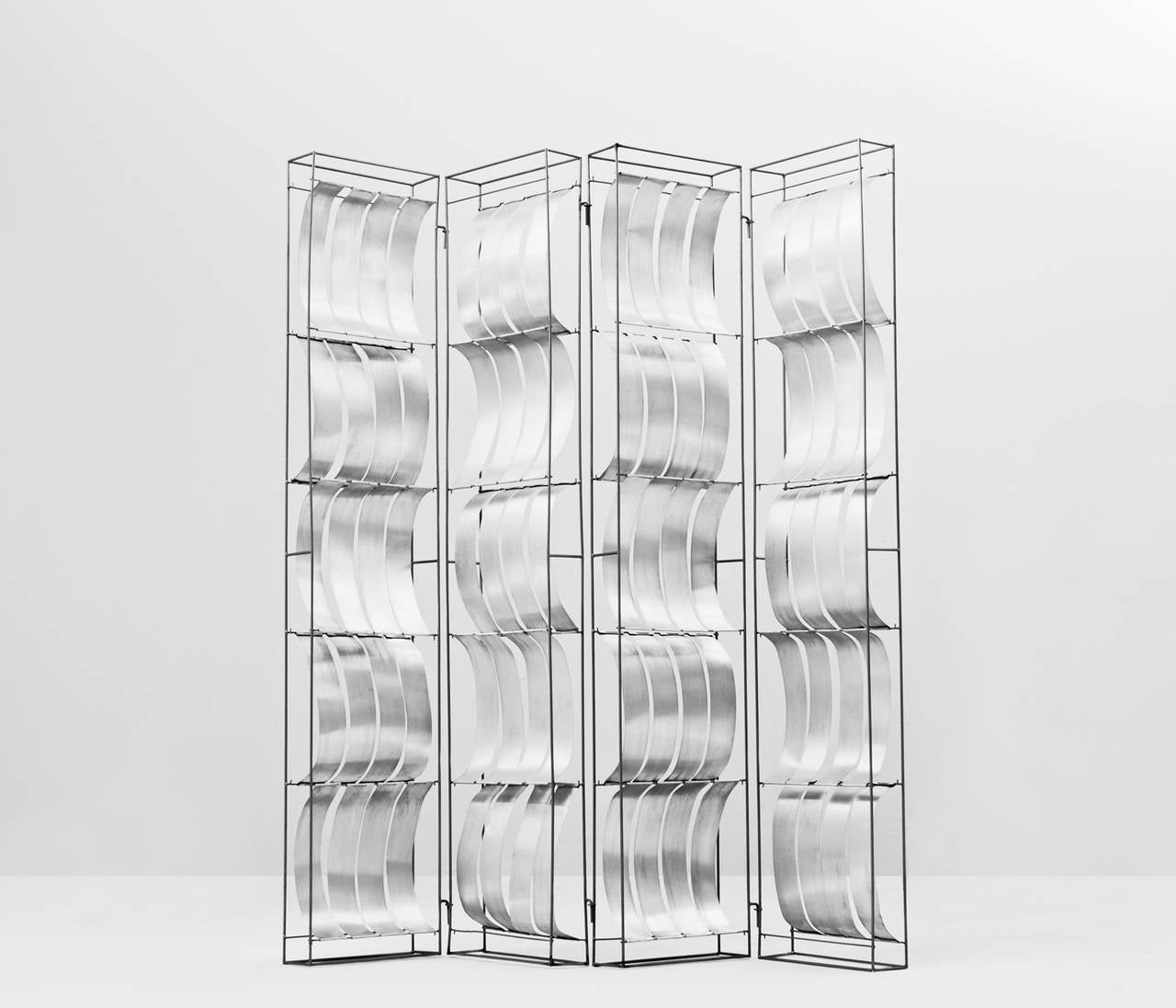 Room devider, in aluminum, by Max Sauze, France 1970s.   Extremely rare room divider by French designer Max Sauze. The light weight aluminum elements in the foldable frame, are placed both convex as concave. This creates a beautiful 3-dimensional