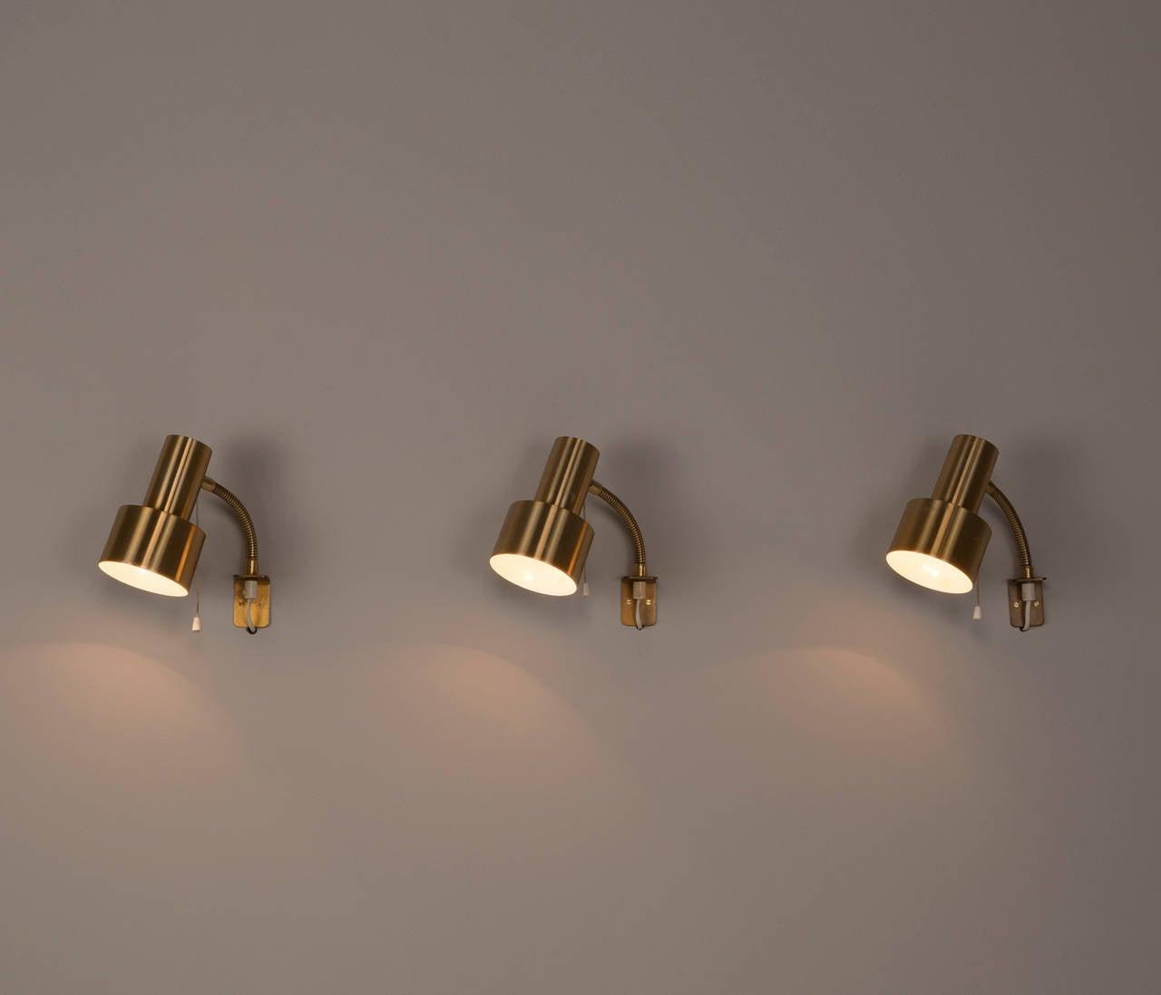 Set of twelve adjustable brass wall lights For Sale at 1stdibs