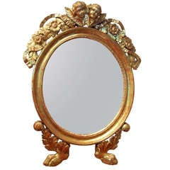 An Italian or French Giltwood Mirror with Putti / Cherubs in Lemon Gilt