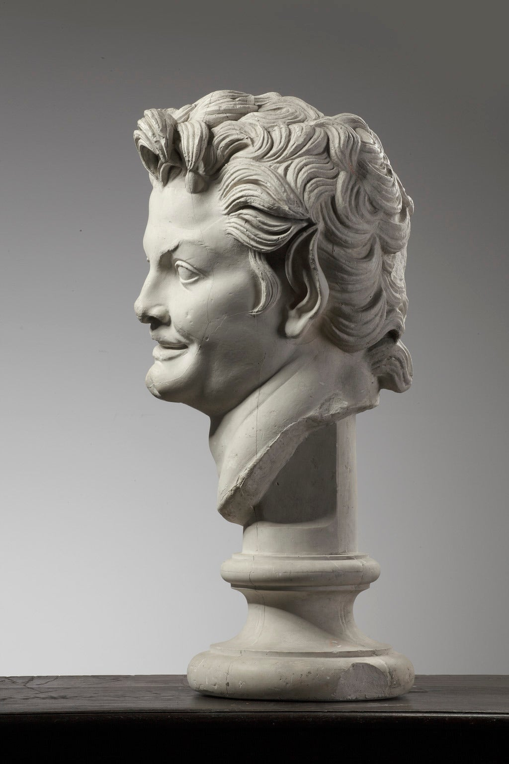 Large Plaster Bust of a Young Man on a Socket In Good Condition For Sale In Baambrugge, NL