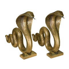 a pair of serpent andirons by E. Brandt