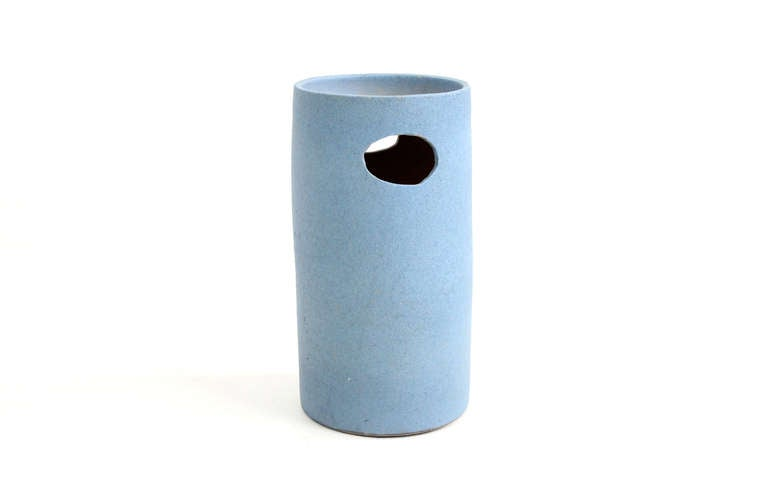 Standing ceramic vessel that could be used as a catch all bowl or umbrella Stand. Strong architectural form.